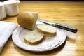 Cut french bread on a white plate Stock Image