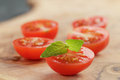 Cut in half cherry tomatoes with basil leaf on Royalty Free Stock Photo