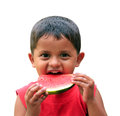 Cut, handsome little indian boy eating watermelon Stock Image