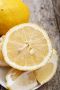 Cut lemon close up on wooden background Stock Photo