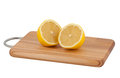 Cut lemon on cutting board. Royalty Free Stock Image