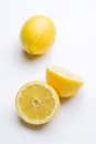 Cut lemon isolated image of with a whole in the background Royalty Free Stock Photos