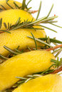 Cut lemon stuffed with rosemary. Stock Photo
