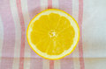 Cut lemon on a towel Royalty Free Stock Image