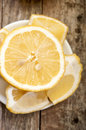 Cut lemon on wooden background close up Stock Photo