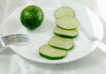 Cut lime on a plate Royalty Free Stock Photo