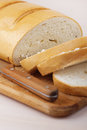 Cut loaf of white bread and knife Royalty Free Stock Photo