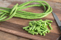 Cut of long bean on wood cutting board. Selective focus.