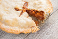 Cut off a piece of American apple pie Royalty Free Stock Photo