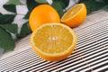 The cut orange on a bamboo napkin Royalty Free Stock Photo