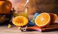 Cut oranges. Pressed orange manual method. Oranges and sliced oranges with juice and squeezer. Royalty Free Stock Photo