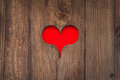 Cut out old wooden red heart shape against a stone wall background Stock Photo