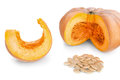 Cut pieces of pumpkin soup and slices and seeds on a white background Stock Photo