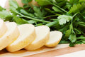 The cut potato on a chopping board Royalty Free Stock Photo