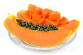 Cut ripe papaya pawpaw or tree melon carica l which rich in betacarotene vitamin c fiber and papine enzyme Stock Image