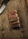 Slices of a grilled beef steak. Barbecue meat. Royalty Free Stock Photo