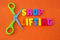 Cut shop lifting text in colorful uppercase letters with scissors to symbolize cutting or reducing crime of orange Stock Images
