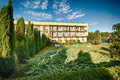Cut shrubs in garden newly with apartment building background Royalty Free Stock Photo