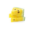 A cut slice yellow watermelon and isolation Royalty Free Stock Photo