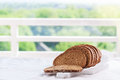 Cut in slices loaf of bread on a cut board on a kitchen background Royalty Free Stock Photo