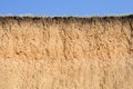 Cut of soil with different layers, grass and sky Royalty Free Stock Photo