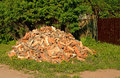 Cut and split firewood stacked in a pile near the house Royalty Free Stock Photo