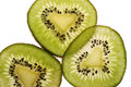Cut three slices kiwi Stock Image