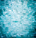 Cut turquoise stacking glass able to use as background Royalty Free Stock Photography