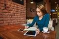 Cut woman lawyer is using digital table,