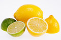 Cut yellow lemons and green limes isolated on white background the Royalty Free Stock Photo
