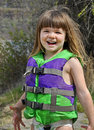 Cute 3 Year Old Girl Muddy in Life Vest Royalty Free Stock Images