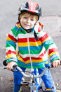 Cute active little boy riding on bike Royalty Free Stock Photo