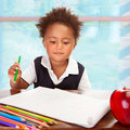 Cute african preschooler portrait of little on drawing lesson have big fresh red apple for lunch in the school elementary Stock Images