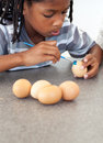 Cute Afro-American little boy painting eggs Royalty Free Stock Image