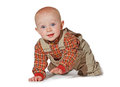 Cute alert baby crawling towards the camera Stock Photos