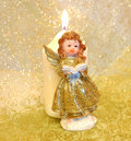 Cute Angel Statue With Candle Stock Photo