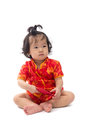 Cute Asian baby girl in traditional Chinese suit with red pocket Royalty Free Stock Photo