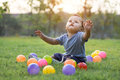 Cute asian baby playing colorful ball in green grass Royalty Free Stock Photo