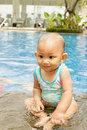 Cute Asian baby at swimming pool Stock Images