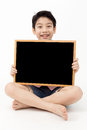 Cute asian Boy Holding Blank board Royalty Free Stock Photo