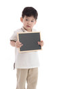 Cute asian boy holding chalkboard on white background Royalty Free Stock Photo