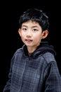 Cute Asian Boy Posing On Black...