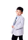 Cute asian boy in suit adorable showing off and pretending to be the boss isolated on white with copy space Royalty Free Stock Images
