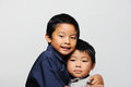 Cute Asian Brothers Stock Photos