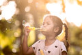 Cute asian child girl having fun to blow soap bubbles in outdoor Royalty Free Stock Photo