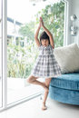 Cute Asian girl doing yoga at home Royalty Free Stock Photo