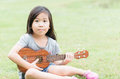 Cute asian girl play Ukulele Royalty Free Stock Photo