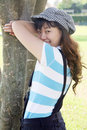 Cute Asian girl playing hide-and-seek Royalty Free Stock Photos