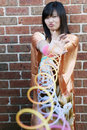 Cute Asian girl playing with slinky toys Royalty Free Stock Photos
