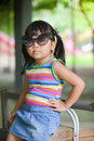 Cute asian girl show her sunglasses at zoo Royalty Free Stock Photo